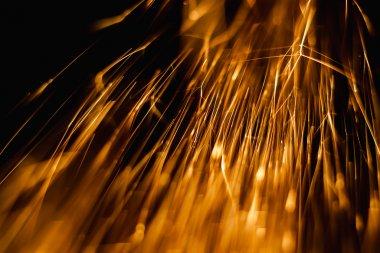 sparks comet-like in dark