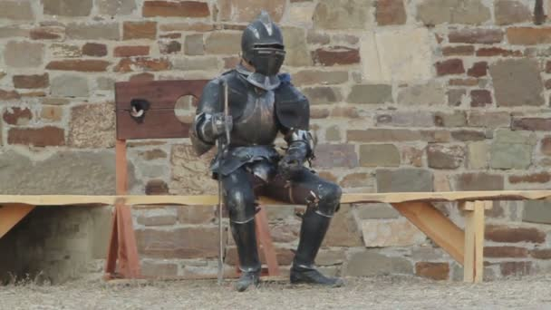 Knights in armor resting in a fortress