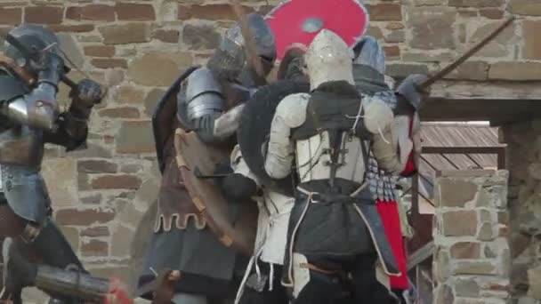 Battle knights in armor in the castle during the day