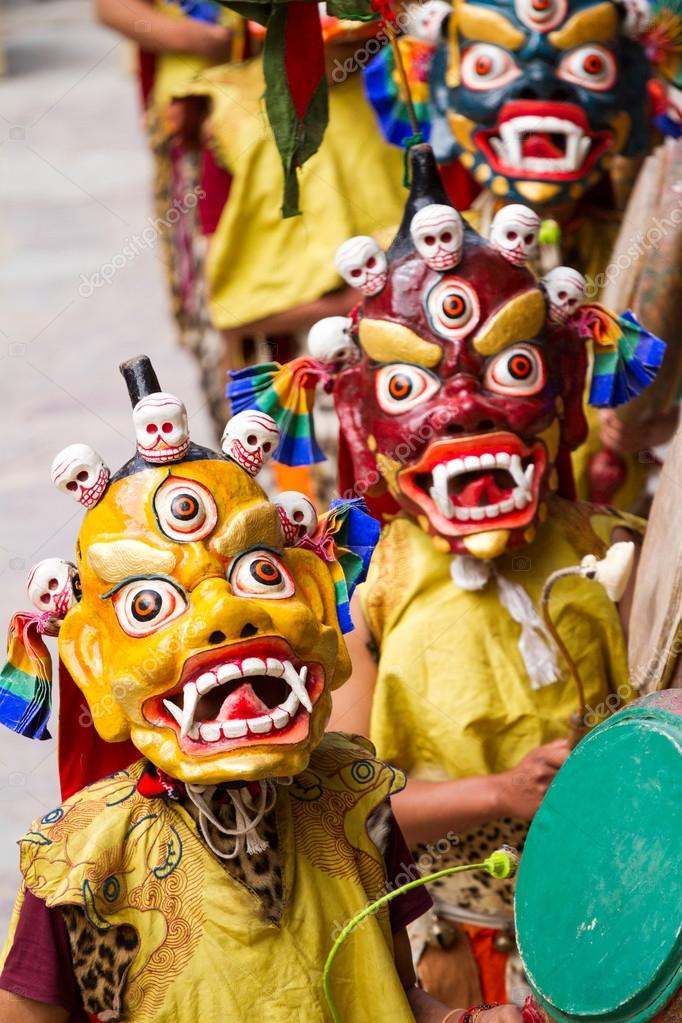3f3f6b7d8 Unidentified monks with drums performs a religious masked and costumed  mystery dance of Tibetan Buddhism during