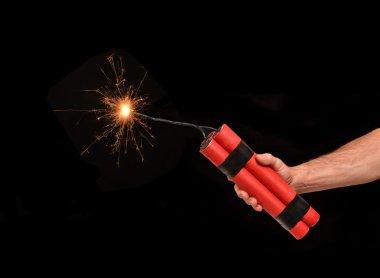 Holding a dynamite stick