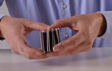 Man hands shuffling cards
