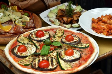 Pizza and food arrangement outside