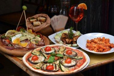 Pizza and food arrangement