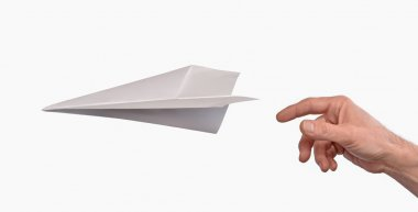 Hand throwing paper plane