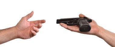 Hand giving a gun