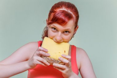 girl eats cheddar cheese