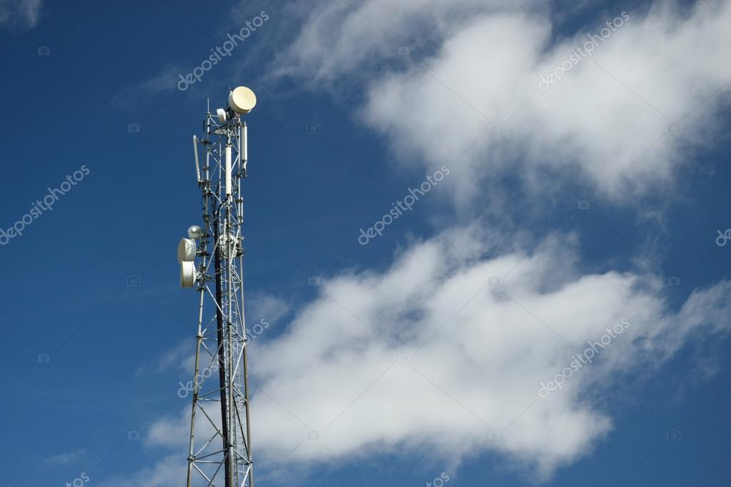Telecommunication tower with blue sky and clouds in the background
