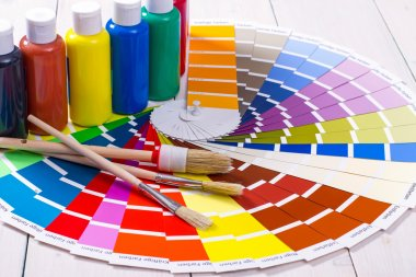 color palette, brush on white wooden background