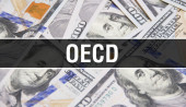Photo OECD text Concept Closeup. American Dollars Cash Money,3D rendering. OECD at Dollar Banknote. Financial USA money banknote Commercial money investment profit concep