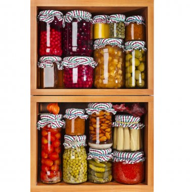 Glass bottles with preserved food