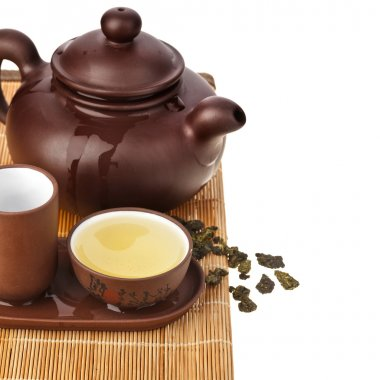 clay teapot and teacup isolated