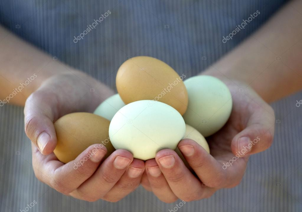 Woman holding Colored Eggs
