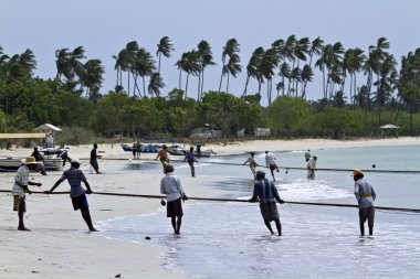 Traditional fishermen in Uppuveli beach, Sri Lanka
