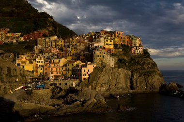 View of Manarola and its harbour at sunset