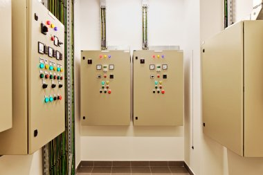 Electrical switch gear and circuit breakers that control heat, heat recovery, air conditioning, light and electrical power supply