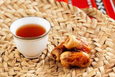 Iconic Abrian fabric with Arabic tea and dates symbolise Arabian hospitality