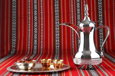 Iconic Abrian fabric with Arabic tea and dates symbolise Arabian hospitality