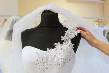 Choosing a wedding dress.