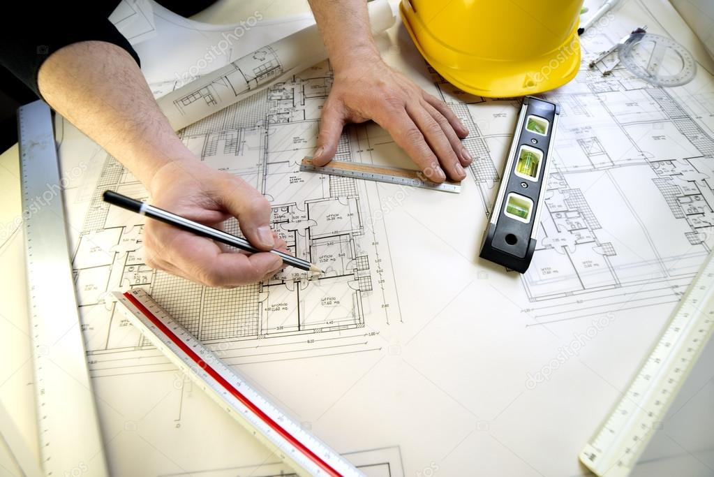 a young architect and the plans for a house