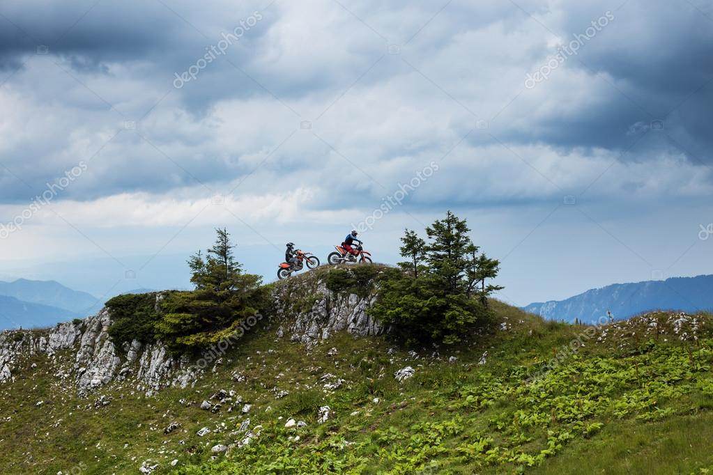 View of two men riding on motorcycles on top of the mountains