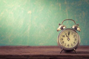 Vintage background with retro alarm clock on tableRetro alarm clock on table