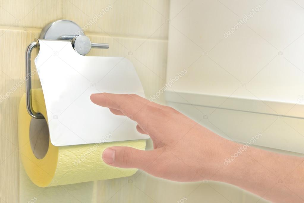 Hand with toilet paper