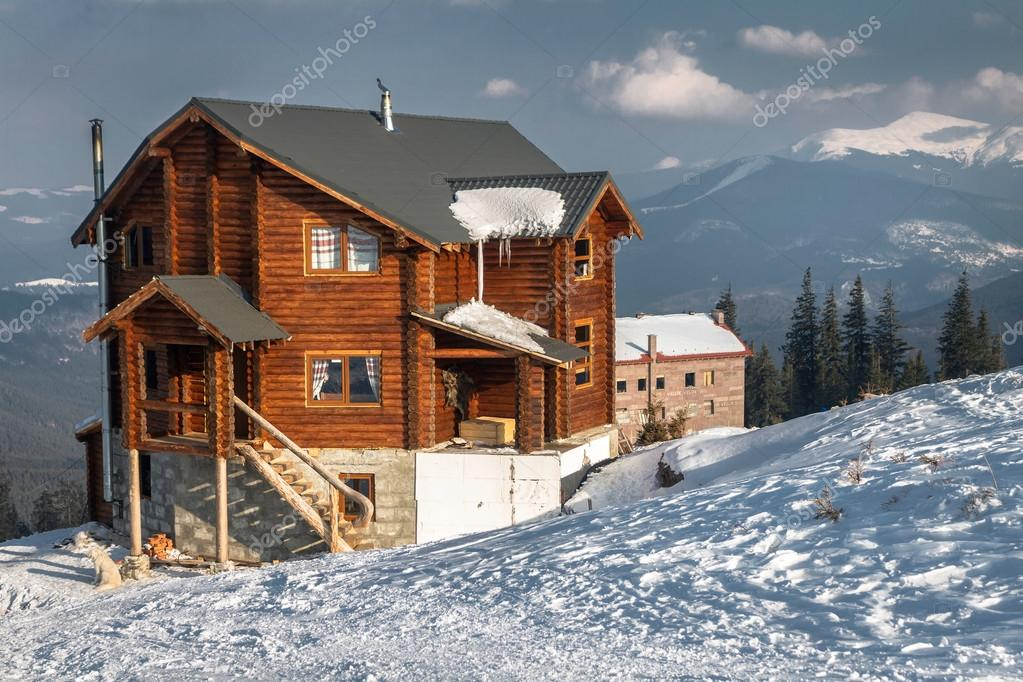 Snow-covered cottage in the mountains