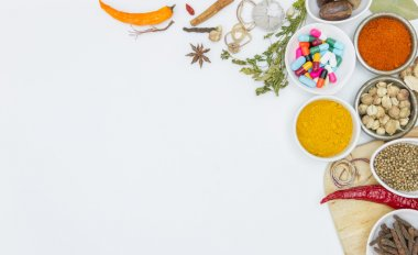 fresh medicinal herbs and spices on a white background.