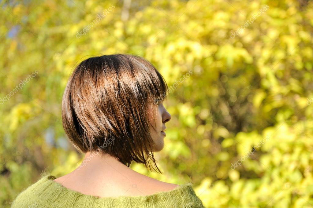 Young woman wearing short bob hairstyle.