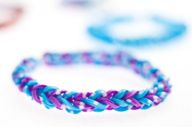Close up of bracelets made with rubber bands.