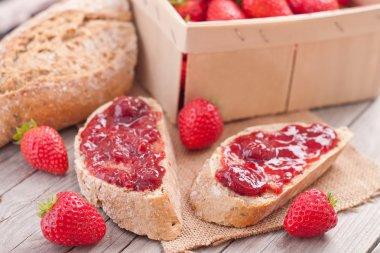sweet strawberries jam on bread slice.