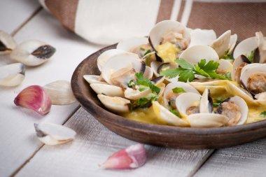 Fresh Cockle clams (Venus, Meretrix) with wine sauce. Portuguese