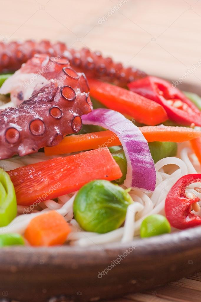 Chinese mix vegetables with pasta and octopus.