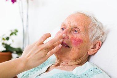 Helpful nurse caring for the senior woman