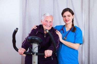 Kind nurse attending a senior woman's training