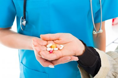 medications given by the doctor to the senior woman