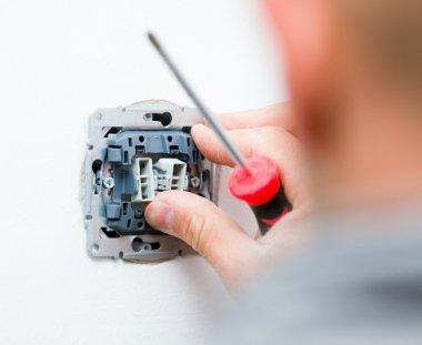 Electrician repair electrical socket