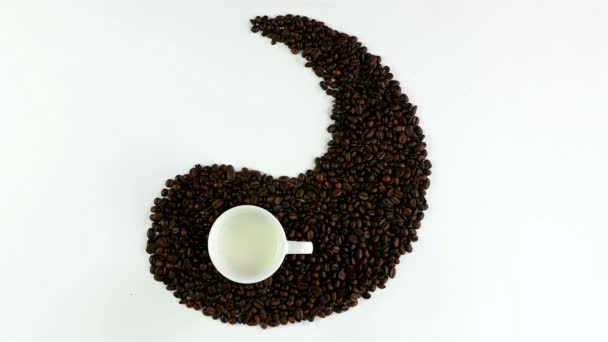 Yin and yang symbol made of coffee