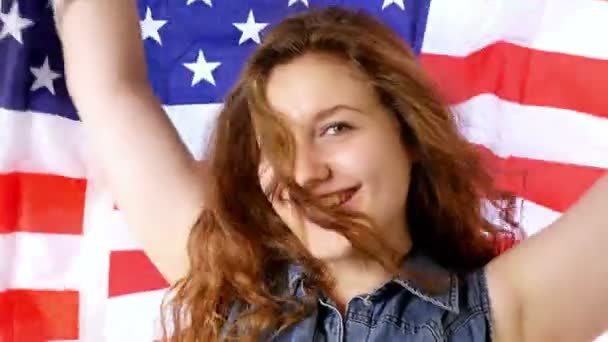 Girl waving a flag of the United States of America