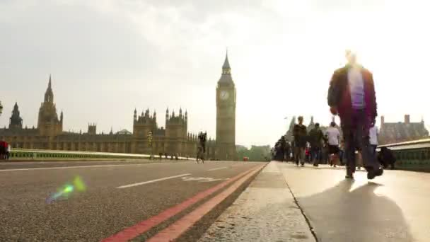 UNITED KINGDOM, LONDON - JUNE 10, 2015:Time lapse of London city rush hour in Westminster Bridge, Big Ben and Houses of Parliament on the back, evening time