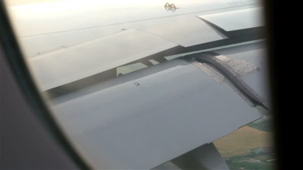 Airplane window view of the wings. Airplane preparing to land. Transportation