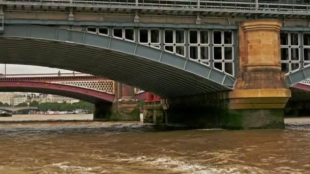 View from tour boat passing under river Thames bridges, London