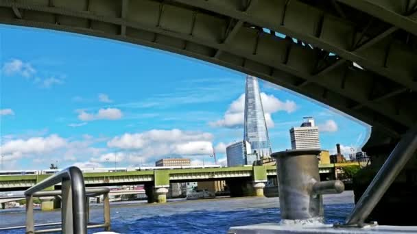 View to the Shard and Thames bridges from a moving boat on river Thames