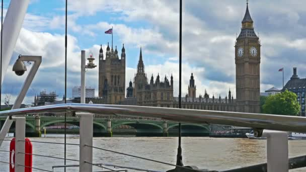 View to Big ben and Houses of parliament from a pier on river Thames, London