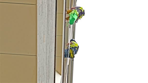 Workers washing the windows facade of a modern office building scyscraper, London