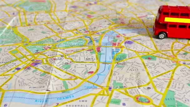 Map Over London.Stop Motion Of The Famous London Red Bus Toy Moving Over A Map Of London