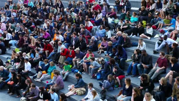 UNITED KINGDOM, LONDON - JUNE 12, 2015: London lifestyle. People watching theatre in the Scoop, London - the open air amphitheatre near Tower Bridge