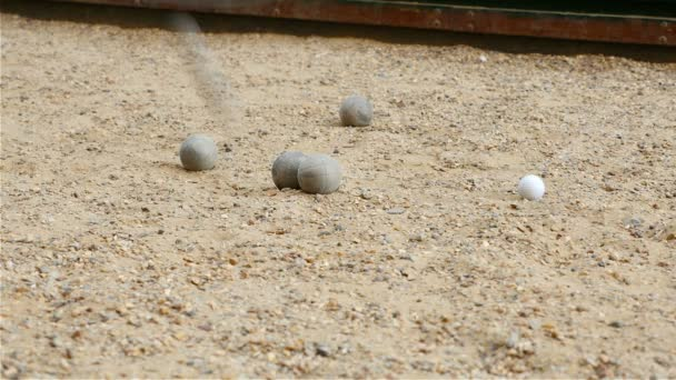 London lifestyle. People playing boules - traditional english game with iron balls