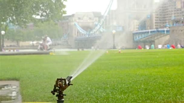 Watering system in a green park near Tower Bridge, London, United Kingdom